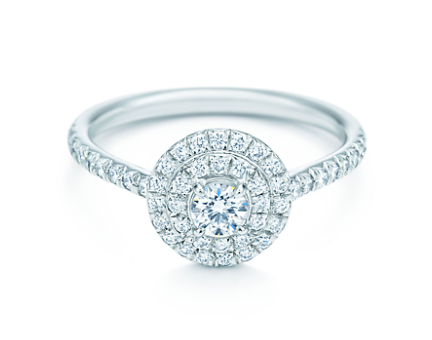 Tiffany & Co. Soleste Round - £3,475. I'm a huge fan of detailed engagement rings and this target ring featuring 0.47ct of central round brilliant diamond encircled by a double row bead-set diamonds is simply stunning. Those surrounding diamonds will only serve to accentuate the size and beauty of the central diamond and dazzle any lucky on-looker.